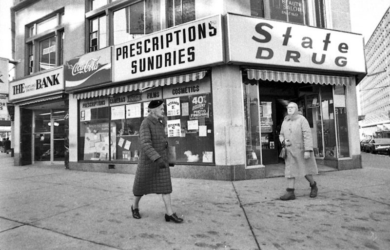 Pedestrians walk by the State Drug store at the corner of High and Congress streets in Portland in the mid-1970s.