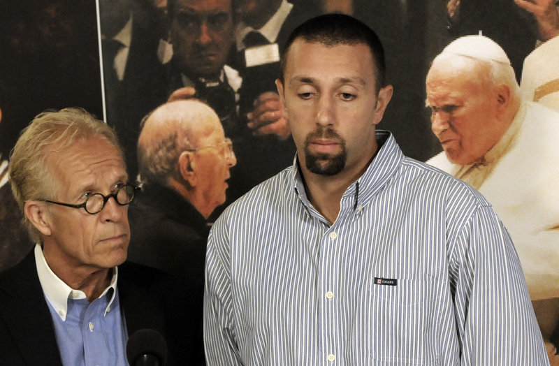 Jose Raul Gonzales, center, says his father was an abusive priest.