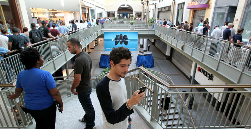 Photos by the Associated Press Yaniv Yarkony uses his old iPhone to record video while standing in line Thursday for the new Apple iPhone 4 at Lenox Mall in Atlanta.