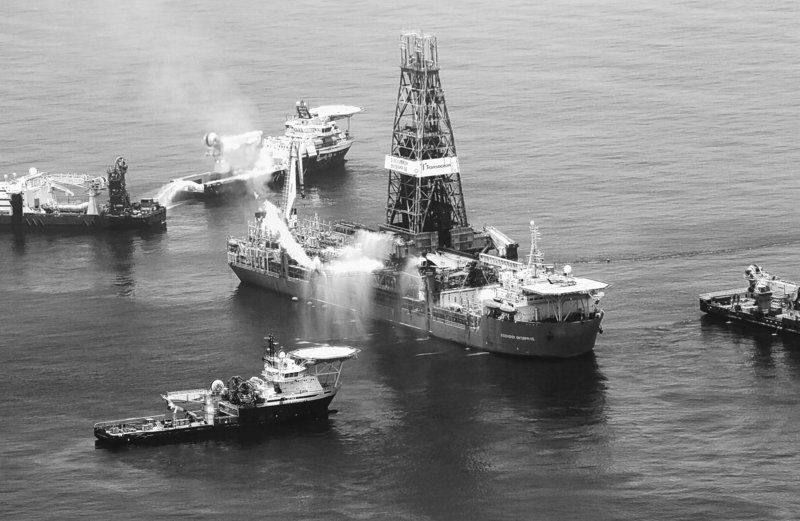 The drilling rig Discoverer Enterprise recovers oil from the leaking Deepwater Horizon site in the Gulf of Mexico earlier this month. BP is deploying deep-water sensors to better determine the amount of oil leaking from the uncapped well, at the same time that work continues on drilling two relief wells.