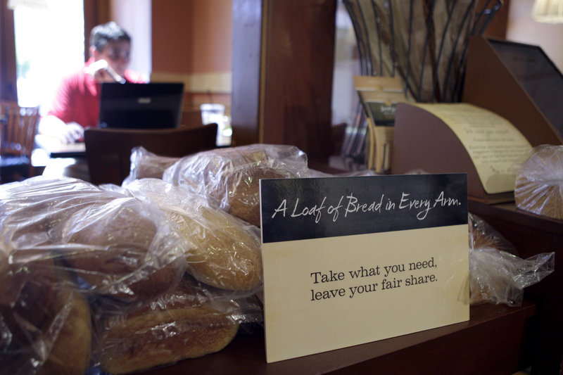 A sign in Panera Bread Co.'s nonprofit restaurant in Clayton, Mo., invites customers to help themselves to bread. The idea is that the richer will pay full price, the poorer, less or none.