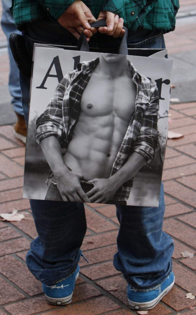 A shopper holds an Abercrombie & Fitch bag in downtown Portland, Ore.