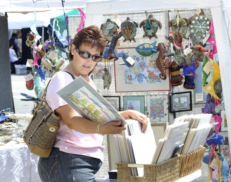 Theresa Casamassa of Saco goes through a basket of prints.