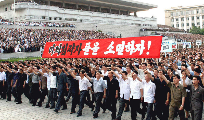 North Koreans chant anti-U.S. slogans in Pyongyang Friday as they mark the 60th anniversary of the start of the Korean War. The country's ruling party will choose new leaders this fall.