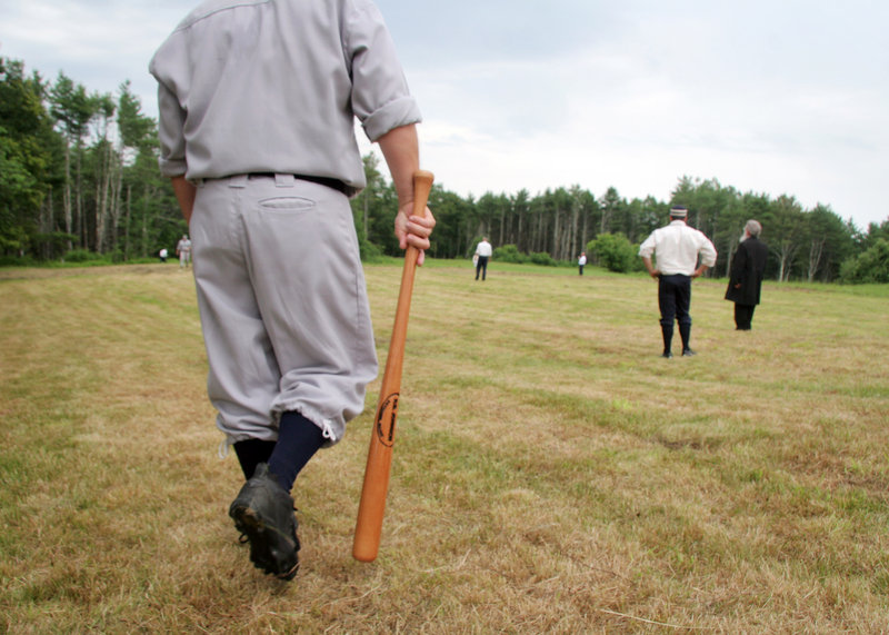 A batter heads to the plate during a vintage baseball game between Dirigo, Maine, and Essex, Mass., at Pettengill Farm in Freeport on Sunday.