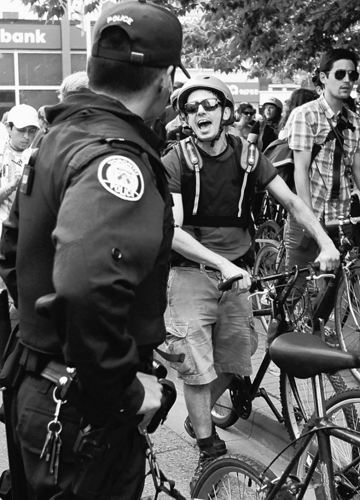 A demonstrator yells as Canadian authorities try to keep him and other bicycle riders on the sidewalk and off the street at a bike block action demonstration in Toronto on Sunday during the G-20 summit meeting. Police said they have arrested more than 560 protesters.