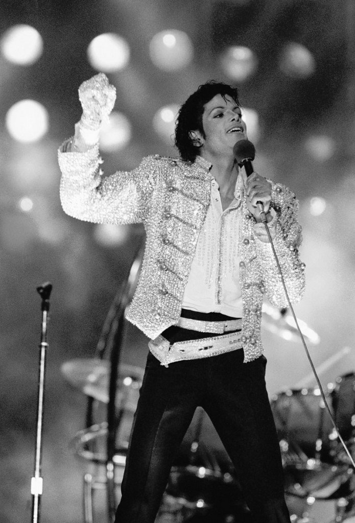 """Singer Michael Jackson performs during his """"Victory Tour"""" in July 1984, wearing the Swarovski-crystal-studded glove that sold for $190,000."""