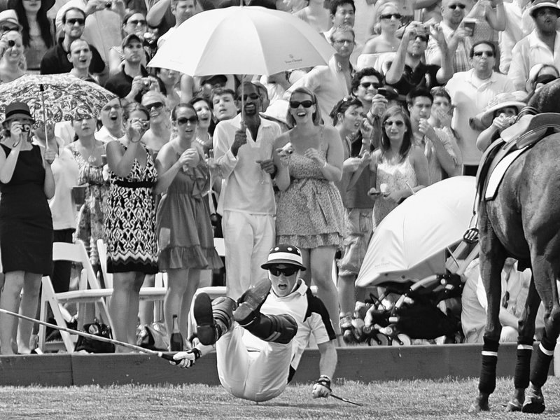 Britain's Prince Harry takes a tumble from his horse Sunday before his defeat in a New York polo match against Argentina's Nacho Figueras. But it was all for a good cause – to benefit 400,000 children of an AIDS-ravaged African nation.