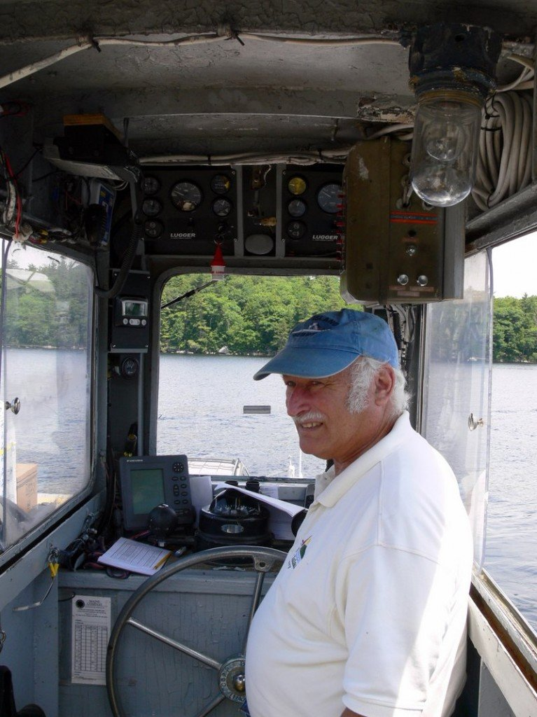 Ross Graham, lead captain of the Frye Island ferries, keeps an eye out as he heads into the dock.