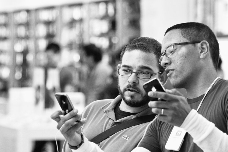 Duane Davis, left, learns about the new features of the Apple iPhone 4 while talking to an Apple employee on June 24, the first day of sales for the new phone, at the Memorial City Mall Apple Store in Houston. Apple Inc. said Monday that it sold more than 1.7 million units of the iPhone 4 in the first three days, making it the most successful product launch in the company's history from the standpoint of sales.