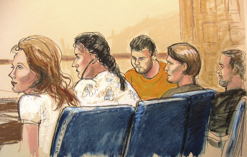 In an artist's drawing, five of the suspects are seen in Manhattan federal court in New York on Monday. Officials say that in addition to the 10 arrests, an 11th suspect is being sought. They are believed to have been deep-cover spies, living in U.S. suburbs and infiltrating policymaking circles.