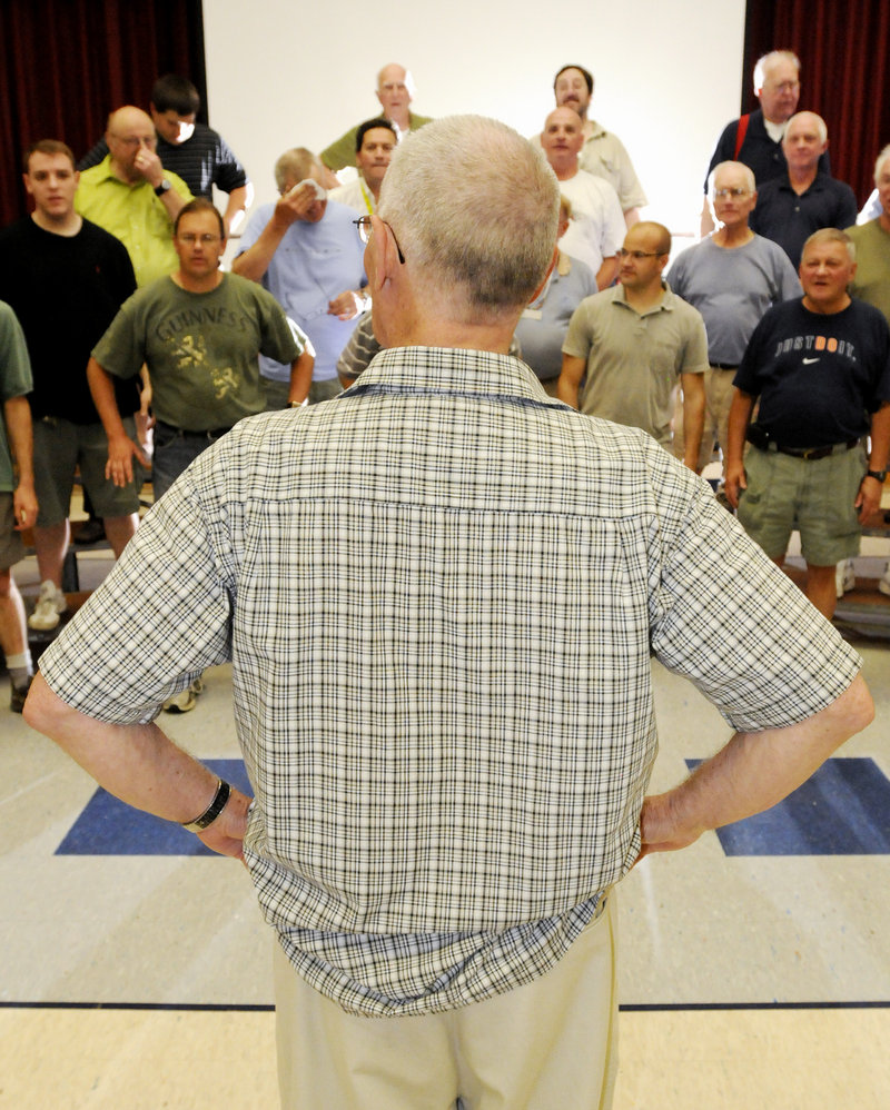 Jack Baggs, director of the Downeasters Barbershop Chorus, gives instructions during the group's final rehearsal before it competes at the International Barbershop Convention in Philadelphia.