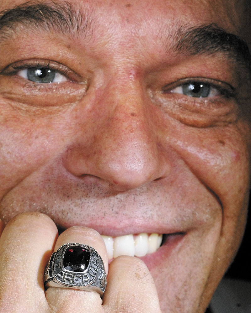 Jason Cottle poses with his Gardiner Area High School class ring that he found this week. He lost it 27 years ago while swimming in a quarry on Granite Hill in Hallowell.