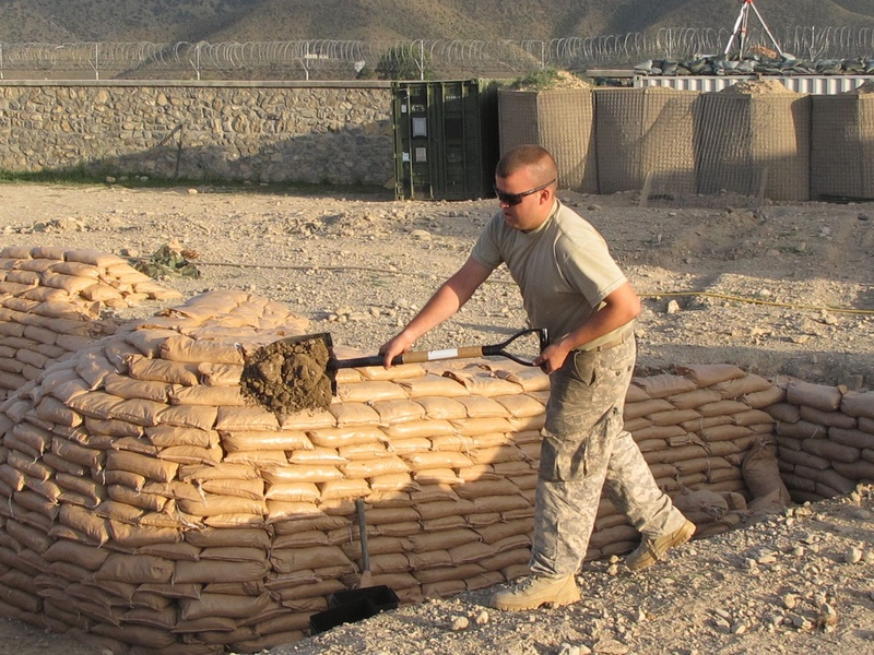 Bravo Company Spc. Mike Desjardins of Berwick works on fortifications Friday at Combat Outpost Dand wa Patan in Afghanistan.