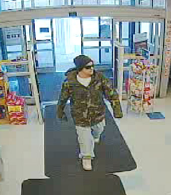 This photo from a surveillance video shows the robbery suspect entering the Rite Aid in Naples on May 10.
