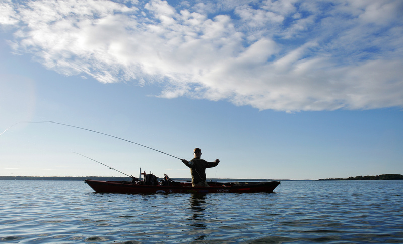 """Adam Taylor of Cumberland fishes for stripers from his kayak in Broad Cove off Cumberland Foreside earlier this month. """"The Maine coast is uniquely suited to fishing for stripers from kayaks,"""" says Taylor."""