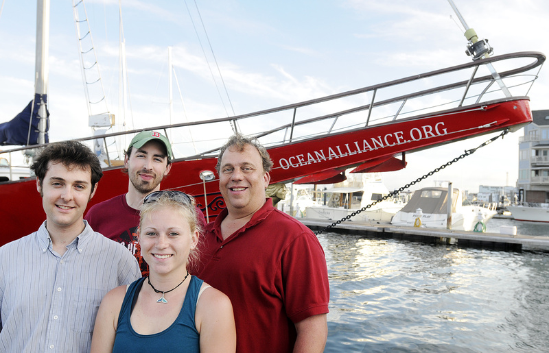 """University of Southern Maine students, from left, Ryan Duffy, 25; Greg Lake, 24; and Catherine Wise, 19; and USM professor John Wise, stand in front of the Odyssey on Friday. Funding for their trip to the Gulf of Mexico is coming from the Ocean Alliance and USM. """"It's an amazing experience to do something this major out in the field,"""" said Duffy, a senior from Falmouth."""