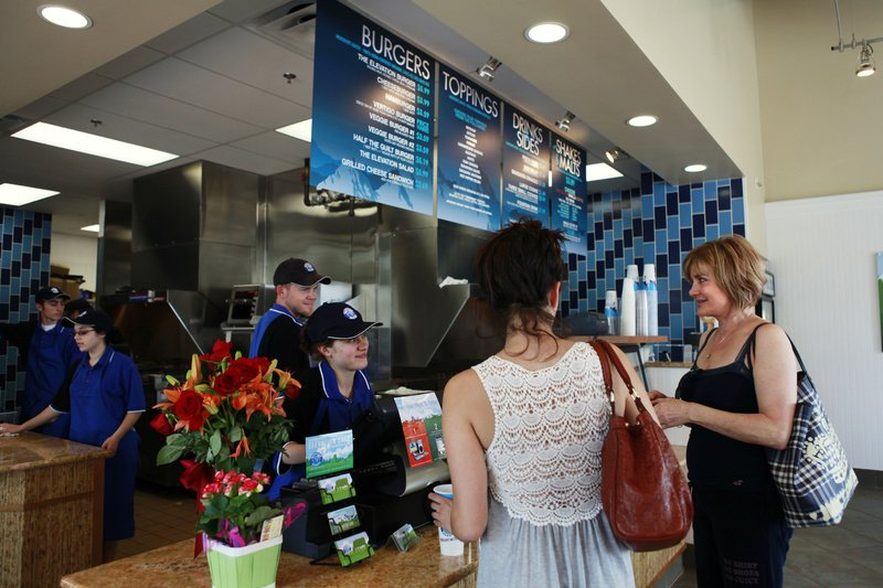 Alexandra Decores, 22, left, and her mother Irena Mihalikova, of Potomac, Md., order lunch at Elevation Burger, in Potomac, Md., last month. Elevation Burger uses organic, grass-fed beef and sells fries cooked in olive oil.