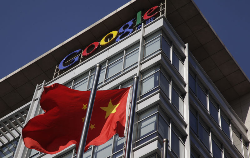 In this file photo, a Chinese flag flutters outside Google's China headquarters in Beijing. Google on Friday, July 9, 2010 said Beijing has renewed the license it needs to continue operating a website in China, securing the search giant's foothold in the world's biggest Internet market despite tensions over censorship.