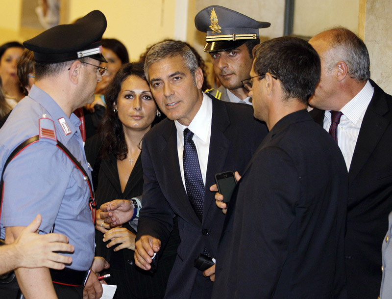George Clooney leaves court in Milan, Italy, today.