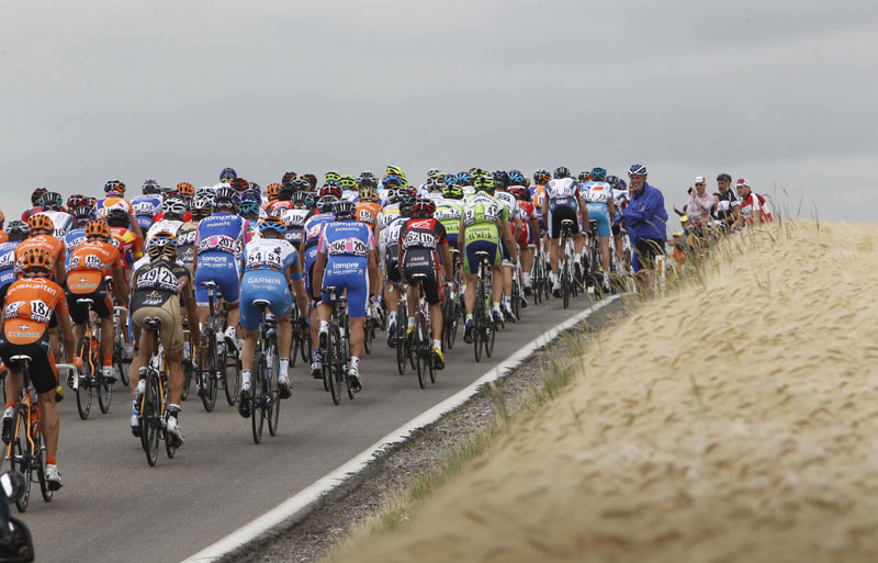 The pack rides during the second stage of the Tour de France over 201 kilometers (125 miles) with the start in Brussels and the finish in Spa, Belgium, today.