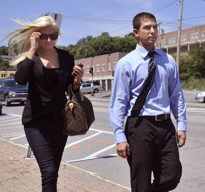 Derek Stansberry, right, and his girlfriend Jillian Krause leave the U.S. Federal Court in Bangor today.