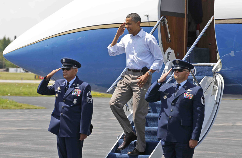 President Barack Obama salutes upon his arrival in Trenton.