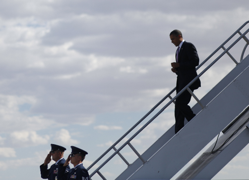 President Barack Obama walks down the stairs during his arrival at McCarran International Airport in Las Vegas, Thursday, July 8, 2010.