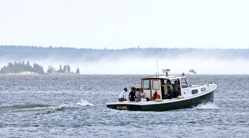 The fog on Frenchman Bay didn't prevent the first family from enjoying a boat tour during their visit to Mount Desert Island. Business owners and others interviewed said disruptions associated with a presidential visit were kept to a minimum.