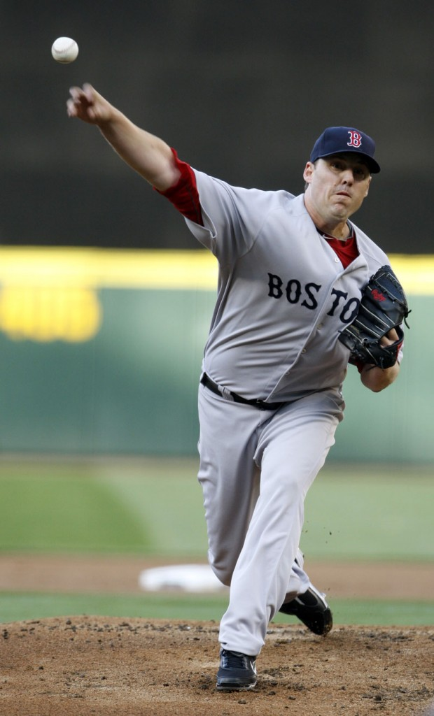 John Lackey delivers a pitch against the Seattle Mariners on Thursday in Seattle. Lackey took a no-hitter into the eighth inning for the Boston Red Sox.