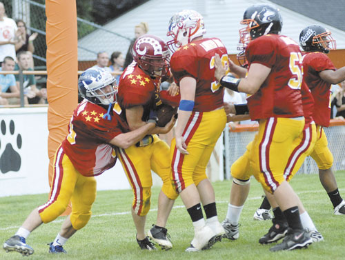 Lonnie Hackett of Bangor saw his high school team reach the Class A championship game last fall, only to lose to Windham. But Saturday, in the Lobster Bowl, it was Hackett scoring the clinching touchdown on a 34-yard run in the fourth quarter at Biddeford and getting surrounded by teammates.