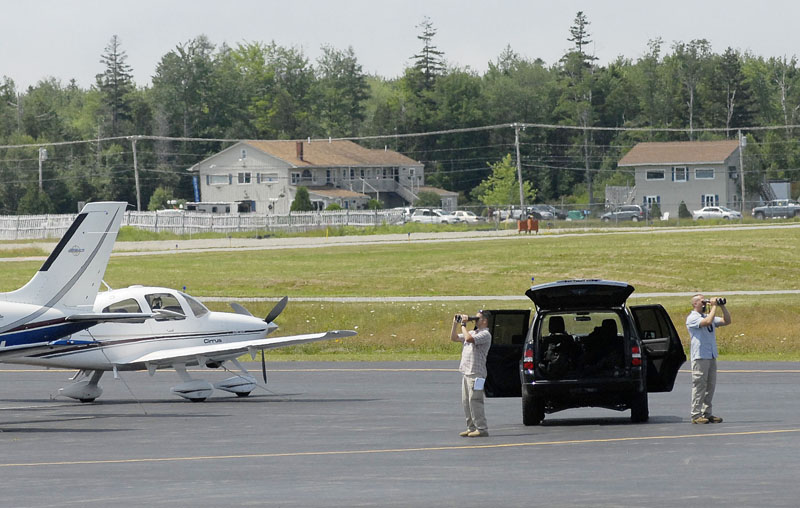 Security personnel look over the scene at airport in Trenton today before the president's arrival.