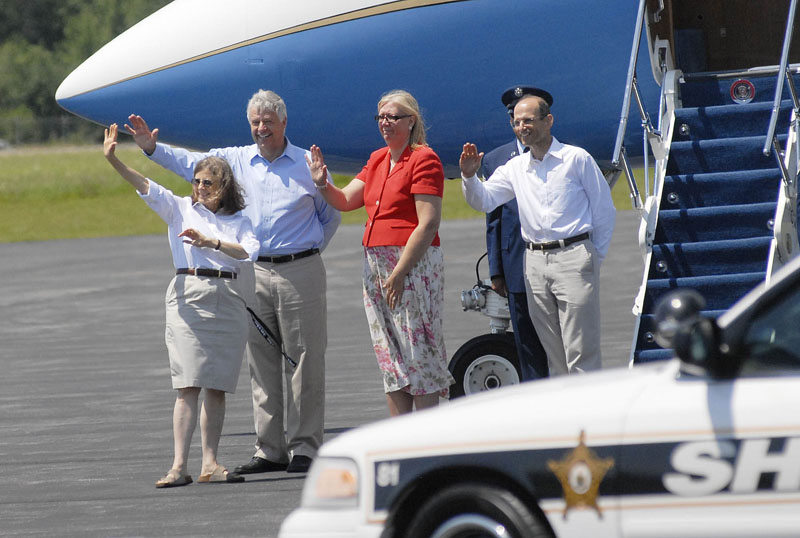 From left: Chair of the Bar Harbor Town Council, Ruth Eveland, U.S. Rep. Mike Michaud, Karen Baldacci and Gov. John Baldacci wave as the president leaves the airport on his way to Mount Desert Island.