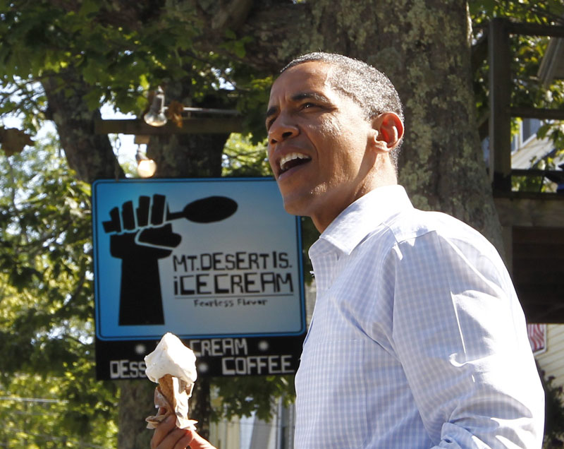 In this July 16, 2010, file photo President Barack Obama holds a coconut ice cream cone after a visit to Mount Desert Island Ice Cream in Bar Harbor.