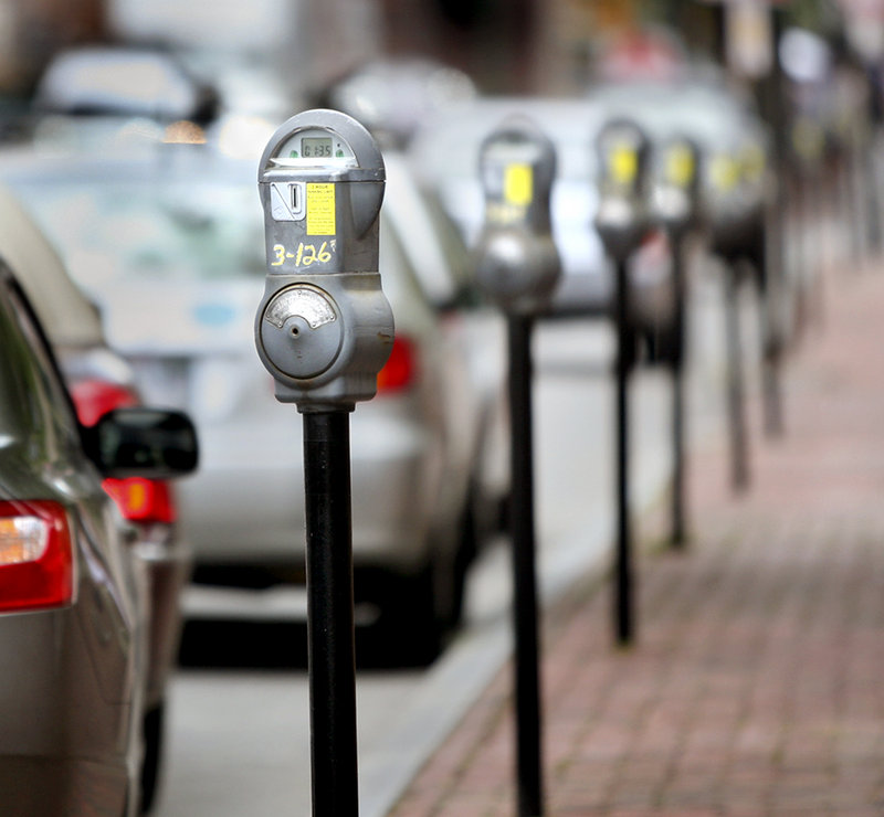 """Meters line Federal Street in Portland. Some say the city should publicize the """"Park and Shop"""" program, which lets businesses give customers a free hour in public garages."""