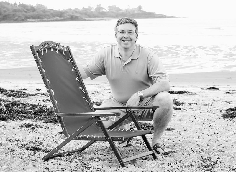 """Every year, something cool sort of comes up where someone wants to talk about them or write about them,"" says Brian Fish, founder of Oh Yeah Comfy beach chairs, posing with one of his creations at Higgins Beach."