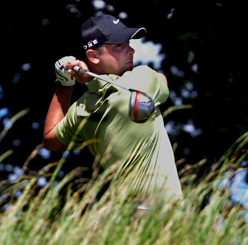 Dustin Cone of Port St. Lucie, Fla., hits a tee shot Wednesday at Riverside Golf Course on the way to a 1-under 71 in the final round of the Portland/Maine Open. Cone, who had 63 in the first round, held on for a one-shot win.