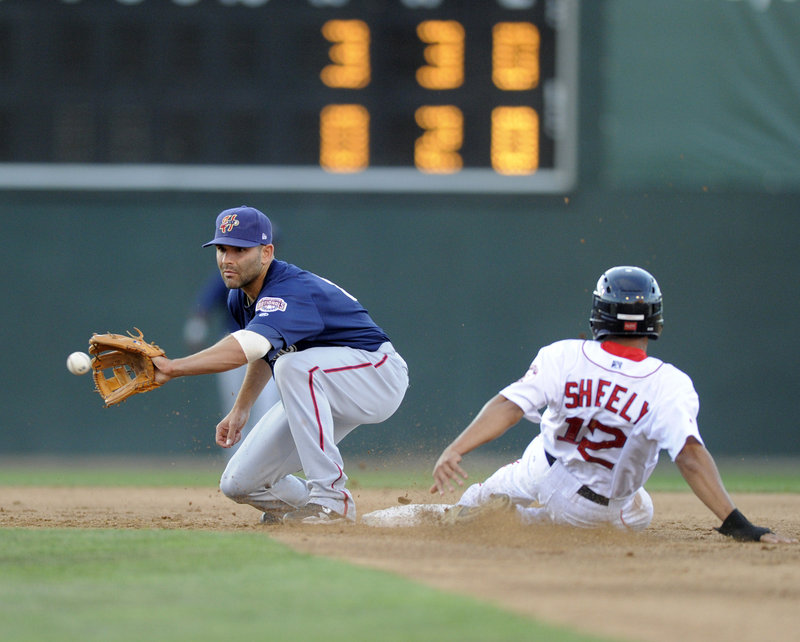 Matt Sheely of the Portland Sea Dogs steals second base in the third inning Wednesday night as Harrisburg shortstop Danny Espinosa takes the throw in Portland's 7-4 victory.