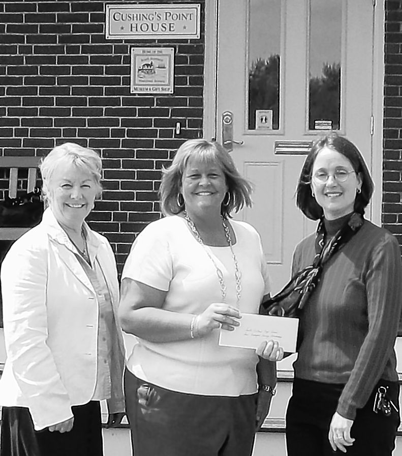 Saco & Biddeford Savings Institution donated $5,000 of the $25,000 that the bank has pledged to the South Portland Historical Society. From left, Betty McGovern, assistant manager of the bank, and Melanie Lee, branch manager, present a check to Kathryn DiPhilippo, executive director of the South Portland Historical Society. The money will fund the historical society's new museum at Bug Light Park. The museum is now open and free of charge.