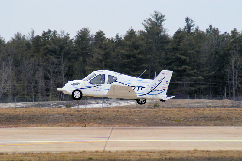 The Transition car-plane is shown taking off. Its makers, Terrafugia, recently gained a waiver to weight restrictions from the Federal Aviation Administration, bringing it closer to production.