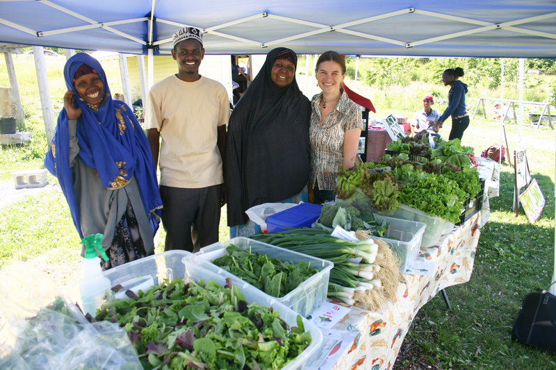 Farmers Batula Ismail, Hussein Muhktar and Seynab Ali and farming program director Amy Carrington at the farmers market operating at the Boyd Street Urban Farm in Portland.