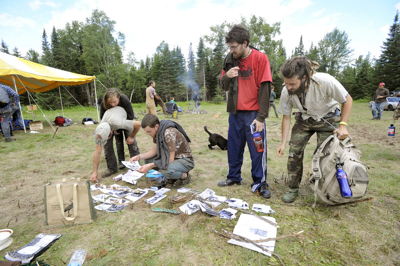 Participants check out booklets after their morning meeting at the North Woods Round River Rendezvous on Saturday.
