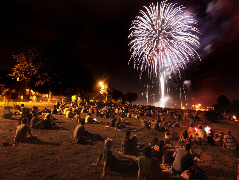Revelers spread out along the Eastern Prom in Portland on Sunday to listen to the Portland Symphony Orchestra and to see Portland's fireworks display. A group of businesspeople paid for the display this year after the city cut funding.