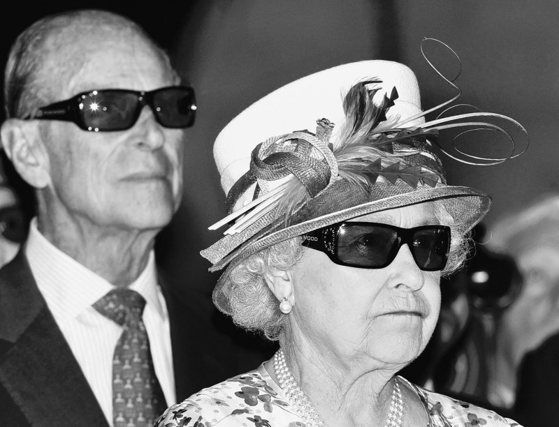 Britain's Queen Elizabeth II and Prince Philip wear 3D glasses to watch a 3-D film at the Pinewood Studios in Toronto, Canada, on Monday.