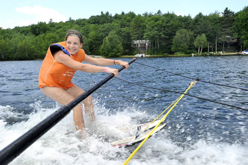 Erin McNeil, 13, of Biddeford, learns to water ski Tuesday. The In His Wakes program came to Windham thanks to Nancy Goslin, a member who raised $100 for each youth who participated.
