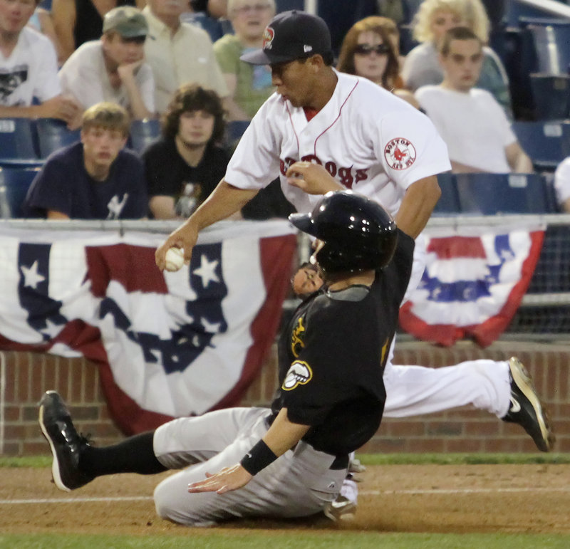 Portland third baseman Ray Chang races to the bag to try to force out New Hampshire's Jonathan Diaz in the sixth inning at Hadlock. Diaz was safe and scored in the inning.