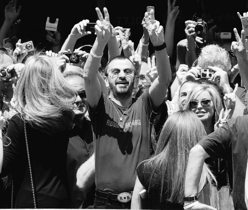 Ringo Starr celebrates his 70th birthday outside the Hard Rock Cafe in Times Square on Wednesday in New York.