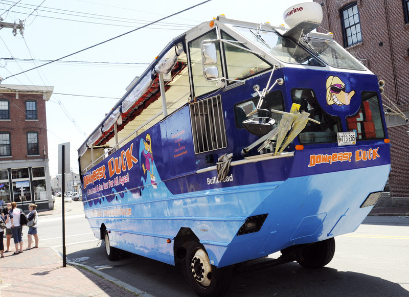 The Downeast Duck Adventures amphibious craft waits for passengers Thursday at Commercial and Pearl streets in Portland.