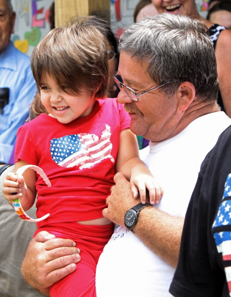 Roy Harrison, right, holds his 4-year-old granddaughter Alisa Maier as she arrives home Thursday in Louisiana, Mo.