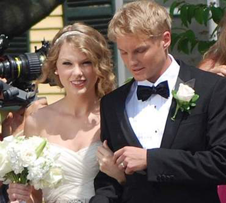 Taylor Swift and an unidentified man shoot a wedding scene for a music video outside Christ Church in Kennebunk on Thursday.